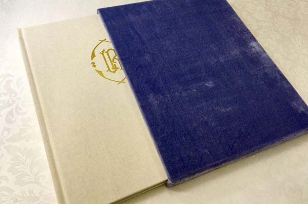 linen-bound book with a purple velvet slip cover